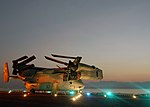 US Navy 071003-N-1189B-072 Lights on the flight deck of the multipurpose amphibious assault ship USS Wasp (LHD 1) illuminate a MV-22 Osprey attached to Marine Medium Tilt-rotor Squadron (VMM) 263 as it transits the Straits of T.jpg