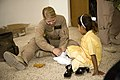 US Navy 071017-M-4393H-028 Navy Lt. Johannah Valentine, with the Area of Operations Denver Iraqi Women's Engagement (IWE) Team, fits an Iraqi girl with new shoes.jpg