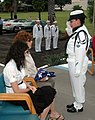 US Navy 071207-N-7310D-098 A Sailor assigned to Naval Station Pearl Harbor's honor guard presents Becky Johnson with an American Flag during an internment ceremony for her father, Richard Adams.jpg