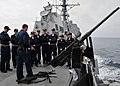 US Navy 080728-N-1488S-001 Gunner's Mate 2nd Class Richard Slade discusses the types of weapons used aboard the guided-missile destroyer USS Kidd (DDG 100) to a group of U.S. Naval Academy midshipmen.jpg