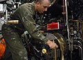 US Navy 080808-N-7668G-123 Conventional weapons handling team member Sonar Technician (Submarines) Seaman Apprentice Neil McGuire, from Athol, Mass., shuts the breech door of the torpedo tube of the fast-attack submarine USS Ne.jpg