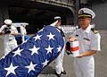 US Navy 080921-N-9079D-053 Lt. Peter T. Le, from Lockport, La., commits ashes to the deep during a burial-at-sea aboard the aircraft carrier USS Abraham Lincoln (CVN 72).jpg