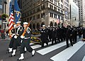 US Navy 081111-N-2636M-173 Sailors march and wave to parade onlookers during New York's annual Veterans Day parade.jpg