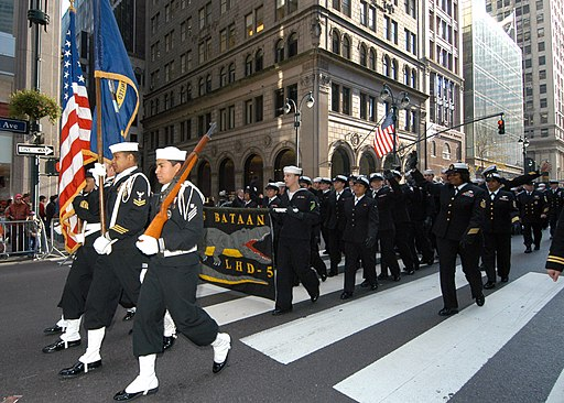 US Navy 081111-N-2636M-173 Sailors march and wave to parade onlookers during New York's annual Veterans Day parade