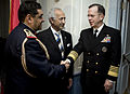 US Navy 090106-N-0696M-026 Adm. Mike Mullen is greeted by Staff Brig. Gen. Ismael H. Alsodani and Samir Al Sumaida'ie at the celebration marking the 88th anniversary of the creation of the Iraqi armed forces.jpg