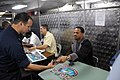 US Navy 090320-N-7730P-036 Retired Buffalo Bills wide receiver Andre Reed and other retired NFL players sign autographs for Sailors on the mess decks of the aircraft carrier USS Ronald Reagan (CVN 76).jpg