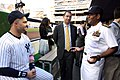 US Navy 090520-N-9013W-004 Vice Adm. Mel Williams, Jr., commander of U.S. 2nd Fleet, speaks with New York Yankees baseball player Nick Swisher, in the Yankee dugout before throwing the first pitch in a game against the Baltimor.jpg