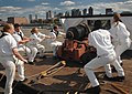 US Navy 090705-N-1928O-012 Sailors assigned to the gun drill team of USS Constitution demonstrate historic drills using a 24-pound Naval long gun.jpg