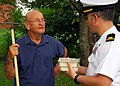 US Navy 090903-N-2903M-024 Ensign Jeff Griffith, assigned to the Nashville Navy Recruiting District, delivers food to Charles Russell of Knoxville as part of the Meals on Wheels program.jpg