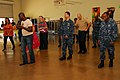 US Navy 091020-N-7544A-090 Sailors assigned to the Navy Operational Support Center (NOSC) learn a Salsa dance routine.jpg