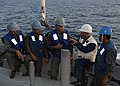 US Navy 091207-N-9520G-070 Chief Boatswain's Mate Jose M.P. Bayuga explains man overboard procedures with sailors from the Royal Malaysian Navy.jpg