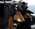 US Navy 100120-N-7508R-014 An air crewman carries a Haitian child to the flight deck triage area aboard USS Bataan (LHD 5).jpg