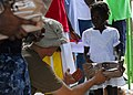 US Navy 100130-N-5244H-059 A Haitian girl receives a meal-ready-to-eat (MRE) from Sailors assigned to the dock-landing ship USS Carter Hall (LSD 50) at a Birey, Haiti school.jpg