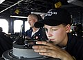 US Navy 100718-N-7638K-143 Ensign Jennifer Gabriel, from Baltimore, Md., verifies the position of the Oliver Hazard Perry-class guided-missile frigate USS Taylor (FFG 50).jpg