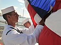 US Navy 100724-N-3283P-036 Seaman Justin Popp prepares to raise the flag during morning colors aboard the guided-missile destroyer USS Russell (DDG 59).jpg