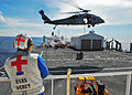 US Navy 100725-N-4044H-209 Hospital Corpsman 3rd Class James Weese observes an MH-60S Sea Hawk helicopter assigned to the Wild Cards of Helicopter Sea Combat Squadron (HSC) 23.jpg