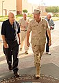 US Navy 101009-N-5429S-007 Vice Adm. Mark Fox, commander of U.S. Naval Forces Central Command, escorts former astronauts Jim Lovell, left, Neil Arm.jpg