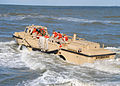 US Navy 101029-N-1580K-109 A lighter amphibious re-supply cargo (LARC) vehicle returns to the surf after delivering its payload onto Anzio Beach at.jpg