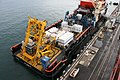 US Navy 110216-N-0000L-001 Deep Submergence Unit (DSU) loads their new surface support ship, the Hornbeck offshore ship (HOS) Dominator.jpg