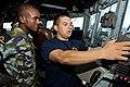 US Navy 110819-N-OV802-035 Quartermaster Seaman Kyle Seaux demonstrates for Kenyan navy 2nd Lt. A.A. Haji how to us the shipboard navigation system.jpg