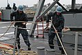 US Navy 110926-N-MZ309-013 Sailors aboard USS Ingraham (FFG 61) haul in lines to get underway for a scheduled deployment at Naval Station Everett.jpg