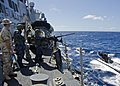 US Navy 111110-N-RI884-041 Sailors aboard the guided-missile destroyer USS O'Kane (DDG 77) observe a rigid-hull inflatable boat.jpg