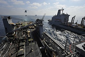 US Navy 120104-N-KS651-151 A helicopter brings supplies to the flight deck.jpg