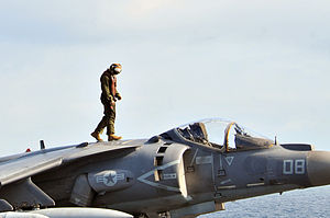 US Navy 120202-N-UM734-412 A Marine assigned to Marine Fighter Squadron (VMA) 231 inspects an AV-8B Harrier before flight operations aboard the amp.jpg