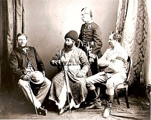 Henry Walter Bellew - Dr. Bellew as an interpreter (left) with Amir Sher Ali Khan (centre), Colonel Frederick Pollock (standing) and Colonel Crawford Trotter Chamberlain (right) in an 1869 photograph in the collection of the British Library