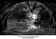 Black-and-white line drawing of an underground river, with a man standing in a boat, holding a flare which lights the arched ceiling.