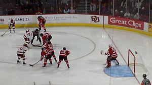 Denver Pioneers - University of Denver (in white) men's ice hockey vs Rensselaer Polytechnic Institute (in red), Magness Arena, Denver, Colorado, USA. DU won 3-0 in this regular season opener. 17 October 2014.