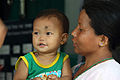 Unnamed mother and child visit the temporary Batulechaur Health Post in Pokhara, Nepal for treatment (10686910263).jpg