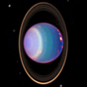 Uranus - A 1998 false-colour near-infrared image of Uranus showing cloud bands, rings, and moons obtained by the Hubble Space Telescope's NICMOS camera.