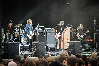 Mastodon (band) - Mastodon performing live in 2012. From left to right: Brann Dailor, Brent Hinds, Troy Sanders and Bill Kelliher.