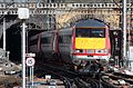 VTEC 225 arrives at King's Cross.jpg