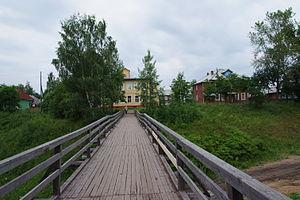 Verkhnetoyemsky District - A wooden bridge in the selo of Verkhnyaya Toyma