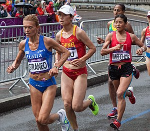 Inés Melchor - Melchor (right) racing in the 2012 Olympic marathon.