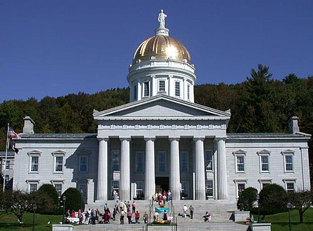 The gold leaf dome of the neoclassical Vermont State House (Capitol) in Montpelier Vermont State House front.jpg