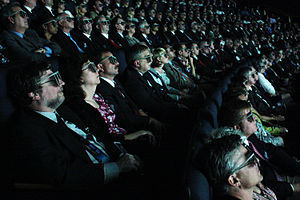 An audience views a film using 3D glasses