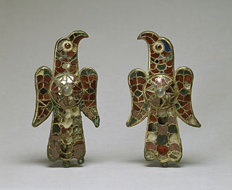Fibula (brooch) - These eagle-shaped fibulae, dating from the 6th century were found at Tierra de Barros (Spain, then the Kingdom of the Visigoths) and are made of sheet gold over bronze. The Walters Art Museum.