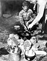 Von Walker and Howe Sadler cooking at their camp site (3367973580).jpg