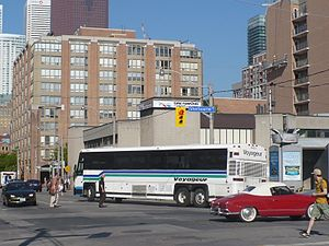Voyageur Colonial Bus Lines - Bus still in an older livery, leaving the Greyhound Courier Express depot in Toronto, in June 2008