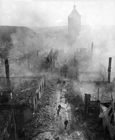 US soldiers advance through the hazy ruins of Waldenburg, Germany, April 1945 Waldenburg1945edit.jpg