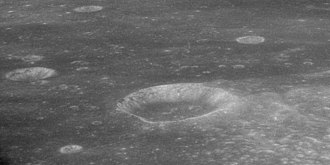 Webb (crater) - Oblique view facing west from Apollo 11, showing Webb at center, with Webb H at left, Webb D at top left, and Webb B above right of Webb itself.