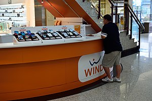 Freedom Mobile - Wind Mobile booth with smartphones on display