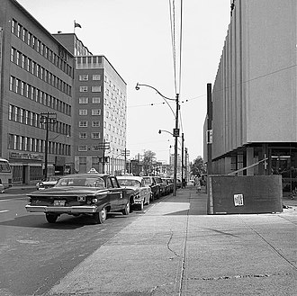 Minto Midtown - Yonge Street looking south from Eglinton Avenue, 1963. The former Ontario Health Insurance Plan building, visible on the left side of the image, was demolished and is now the site of the Minto Midtown residential complex.