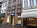 'Chocolatier Van Oost at Wollestraat 11, The Bottle Shop at Wollestraat 13, and Chocoladehuisje at Wollestraat 15' by Tania Dey.JPG