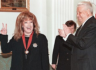 Alla Pugacheva - President Boris Yeltsin awards the 2nd Degree Order of Merit for the Fatherland to Pugacheva, 15 April 1999.