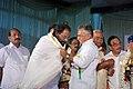 യേശുദാസിനെ സ്കൂൾ കലോത്സവവേദിയിൽ പൊന്നാട അണിയിക്കുന്നു.JPG