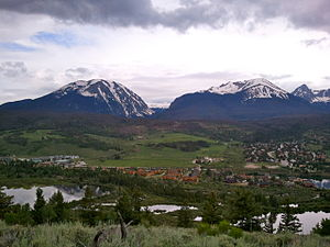 Silverthorne seen from a nearby mountain. In the background Buffalo Mountain is on the left, while Red Mountain and Mount Silverthorne are located adjacent to each other to the right.
